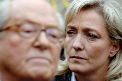 "(FILES) - A photo taken on March 17, 2007 shows Marine Le Pen (R) listening to her father, France's far-right Front national party's (FN) president and presidential candidate Jean-Marie Le Pen, as he delivers a speech in his house in La Trinite-Sur-Mer, western France. France's far-right was plunged into disarray on April 8 as National Front leader Marine Le Pen openly split with her father and party founder after gas chamber comments she described as ""political suicide"".  AFP PHOTO / MARTIN BUREAU"